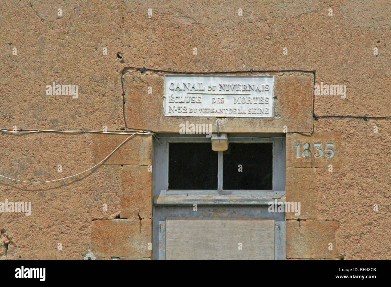 Frontage of the old lock-keeper's on the Canal de Nivernais. - Stock Image