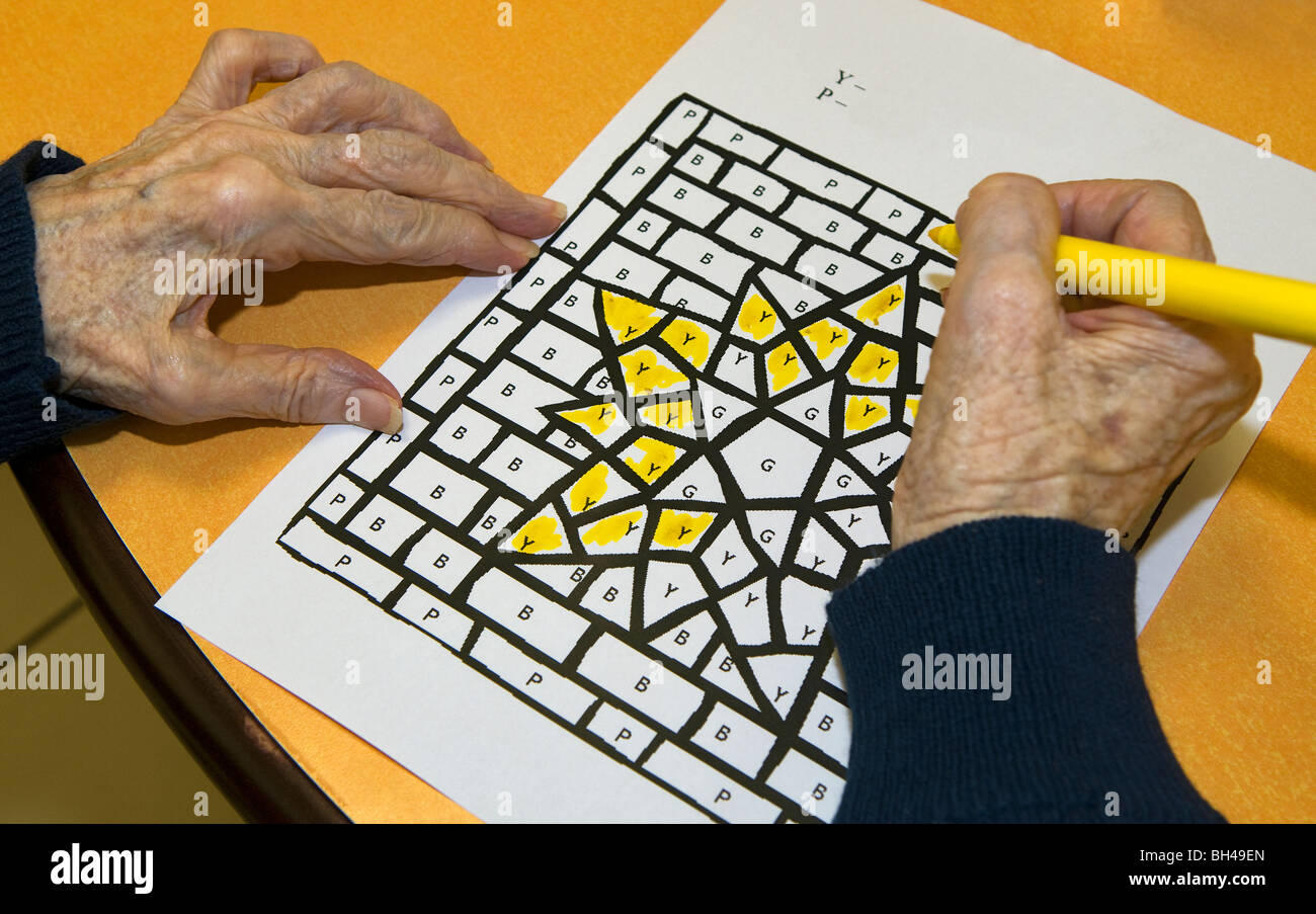 Resident of a retirement home performing a coloring exercise. - Stock Image