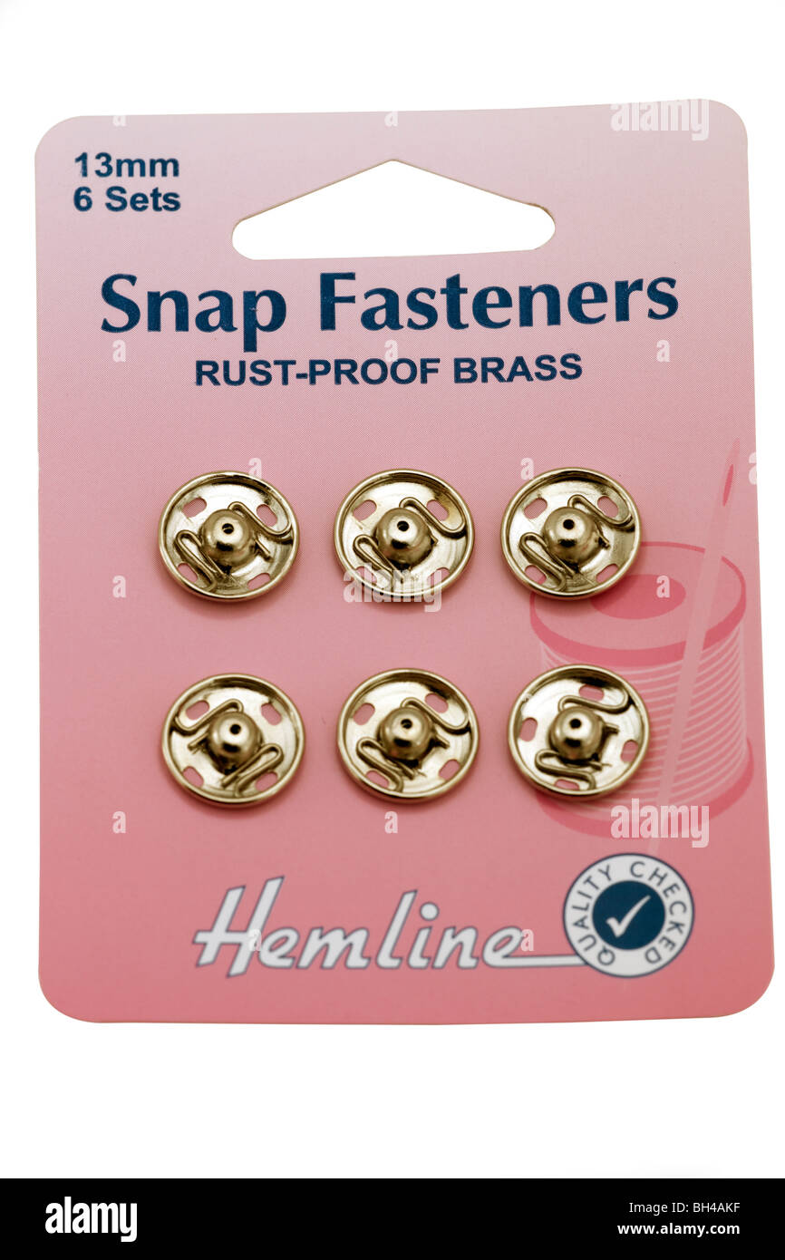 Pink card with six rust proof 13mm snap fasteners - Stock Image