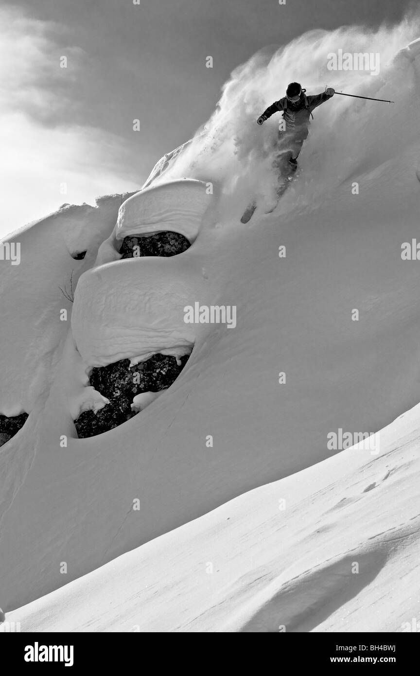 A man skiing a steep slope in Jackson Hole, Wyoming. - Stock Image