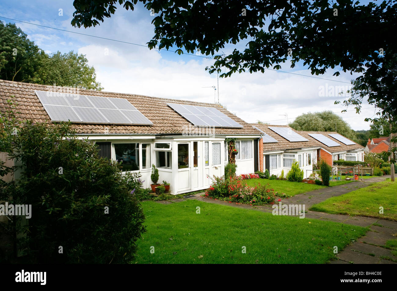 Solar panels on a bungalow - Stock Image