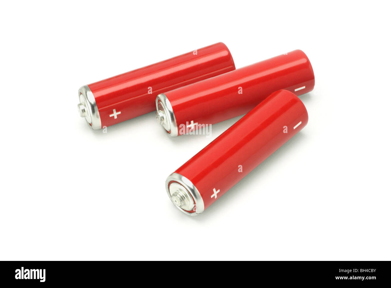 Three red AA size batteries on white background - Stock Image