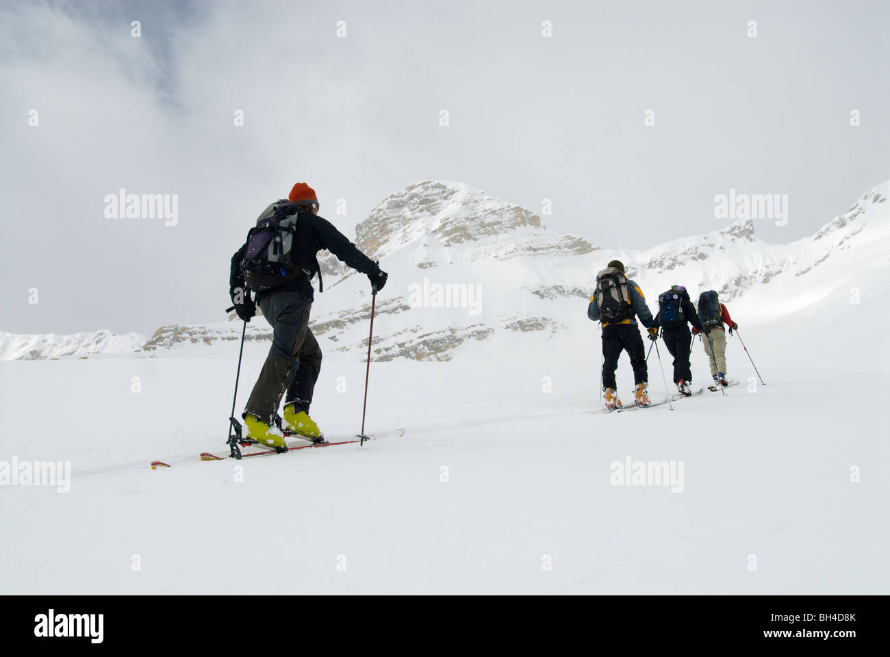 Skiers tour in the backcountry of the Canadian Rockies. - Stock Image