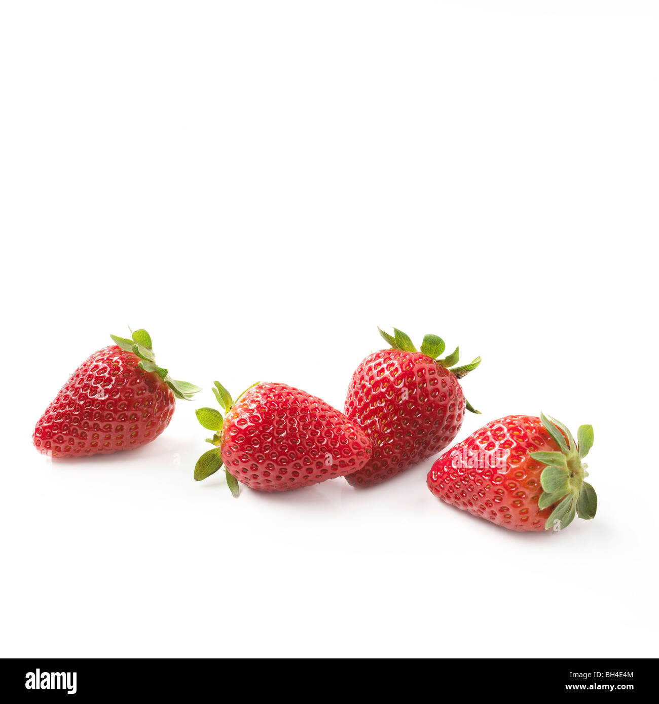 Strawberries on a white background - Stock Image