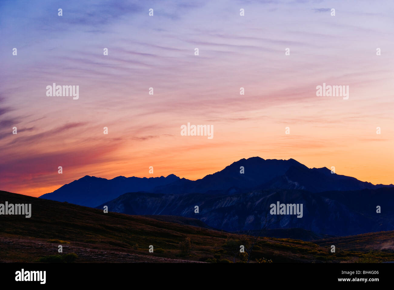 Mountains and sky at dusk from Sable Pass, Denali National Park, Alaska - Stock Image
