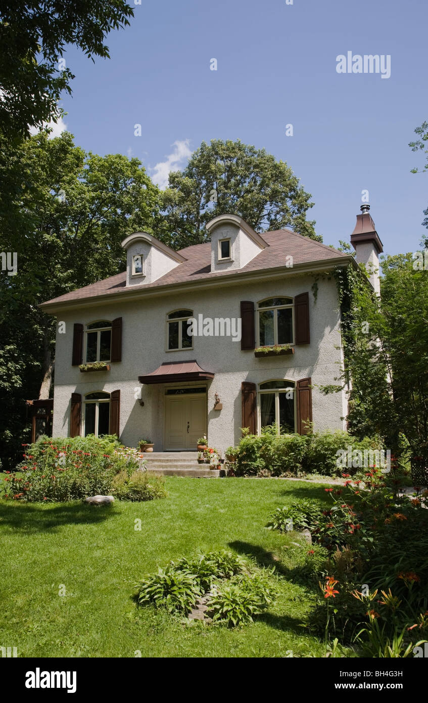 Two-story French manor home with landscaped front yard, Laval, Quebec Stock Photo