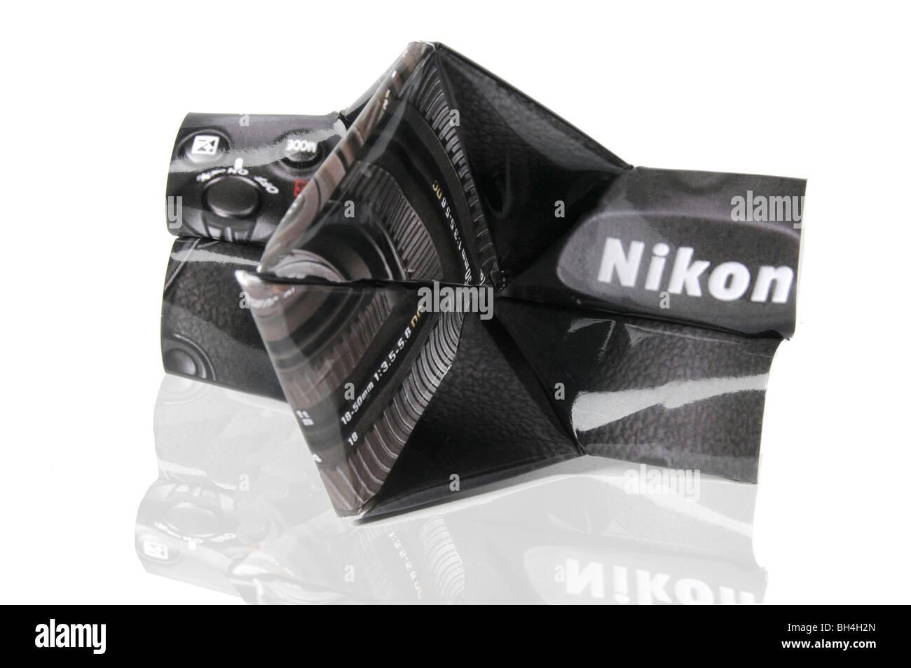Origami Camera - Nikon D300. Studio shot on white background - Stock Image