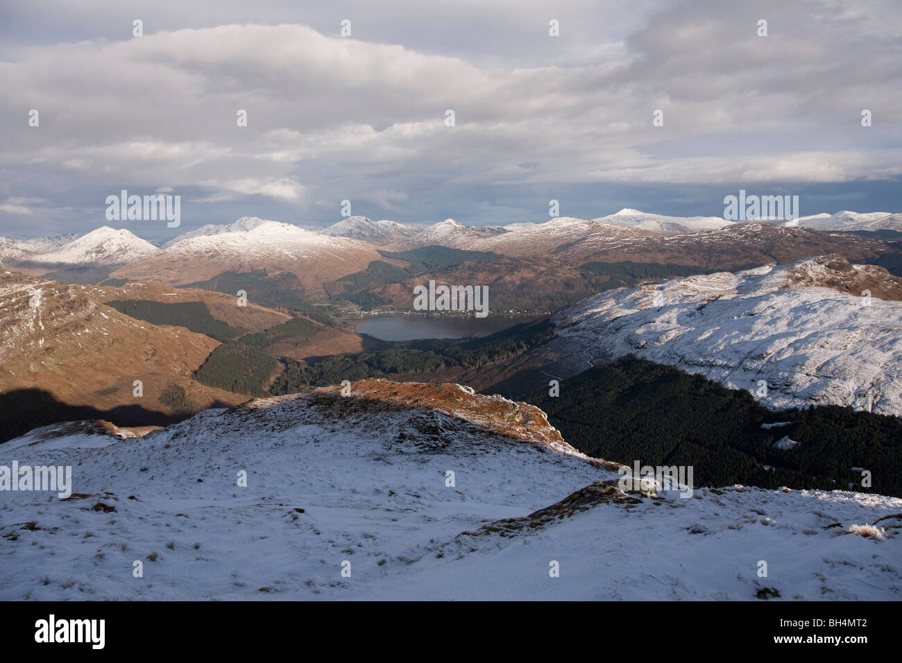 The Arrochar Alps, Beinn Donich and Bein Brack with Loch Goil in the distance from Beinn Bhula Stock Photo