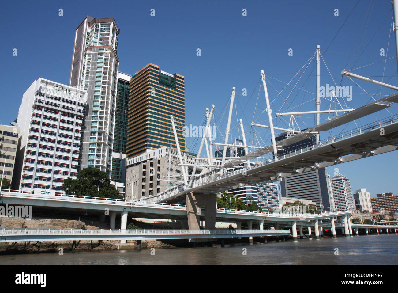Kurilpa Bridge and Brisbane City Centre in Queensland, Australia on a sunny day - Stock Image