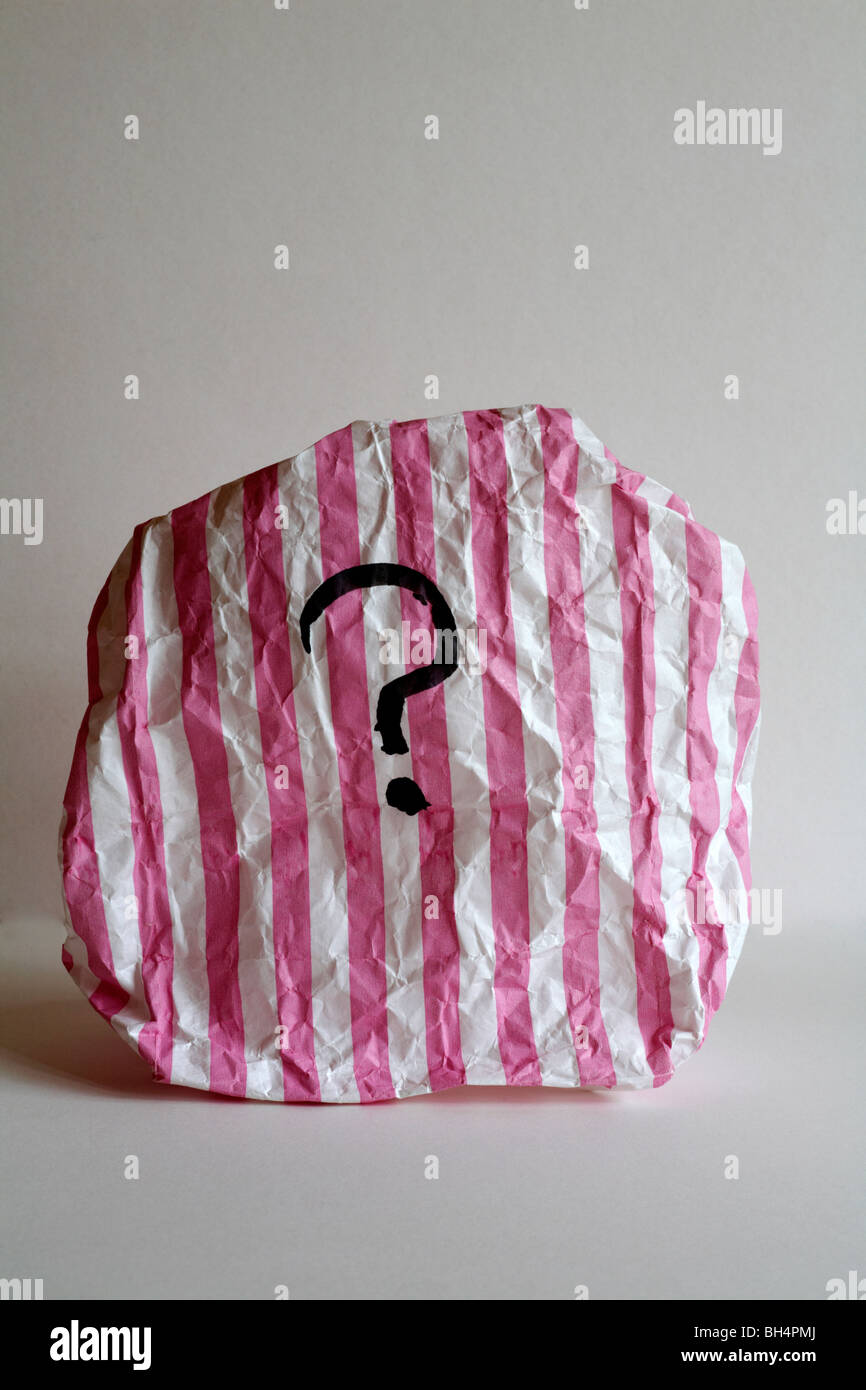 pink and white striped paper bag with question mark on - Stock Image