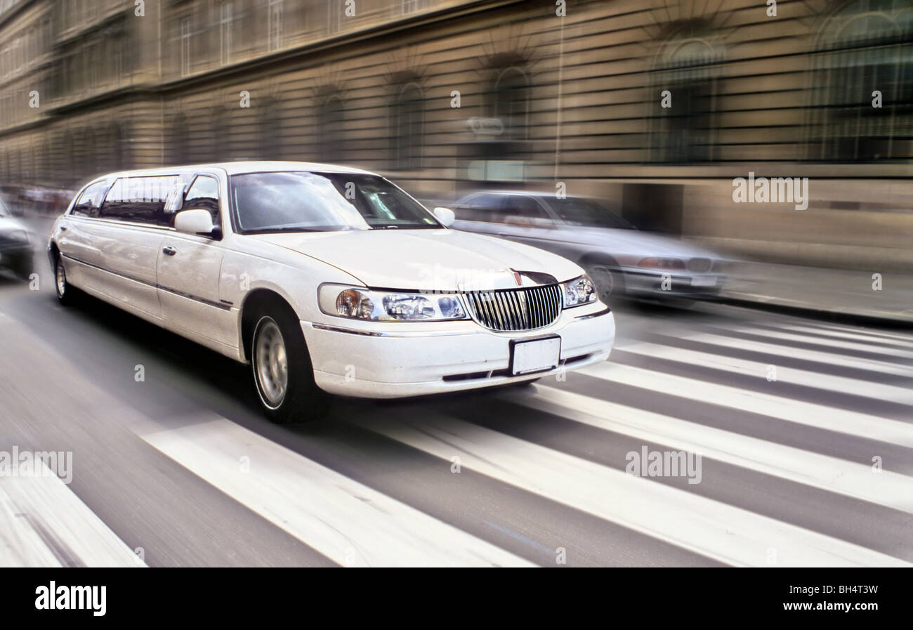Long car limousine running speedy in Paris - Stock Image