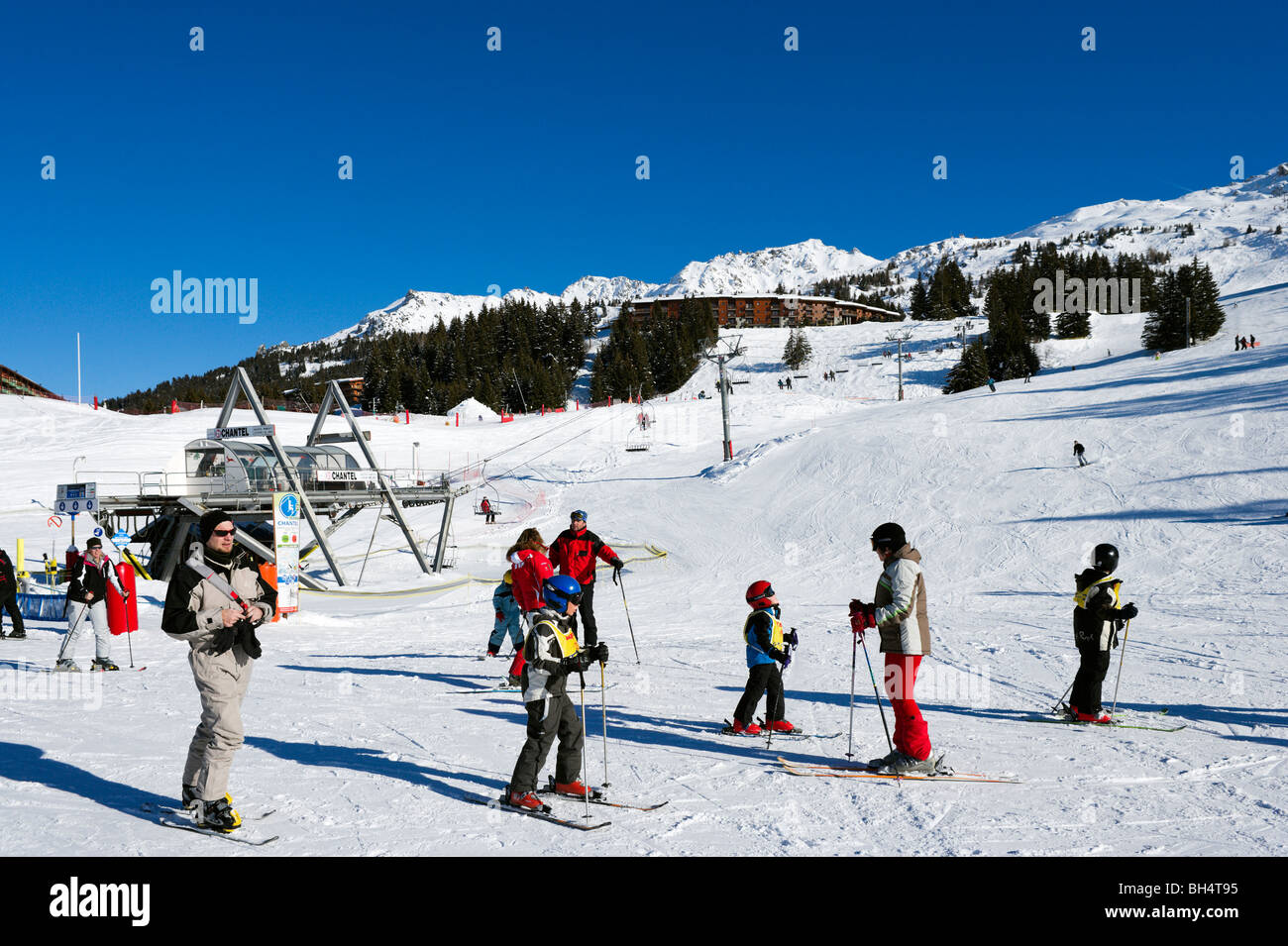 Bottom of the Chantel chair lift in the resort centre, Arc 1800, Les Arcs, Tarentaise, Savoie, France - Stock Image