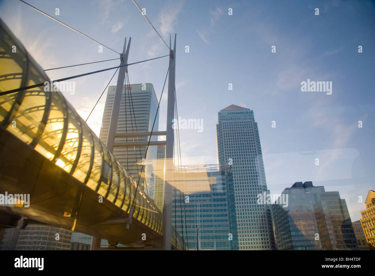 canary wharf docklands light railway DLR  foot bridge seen from the train - Stock Image