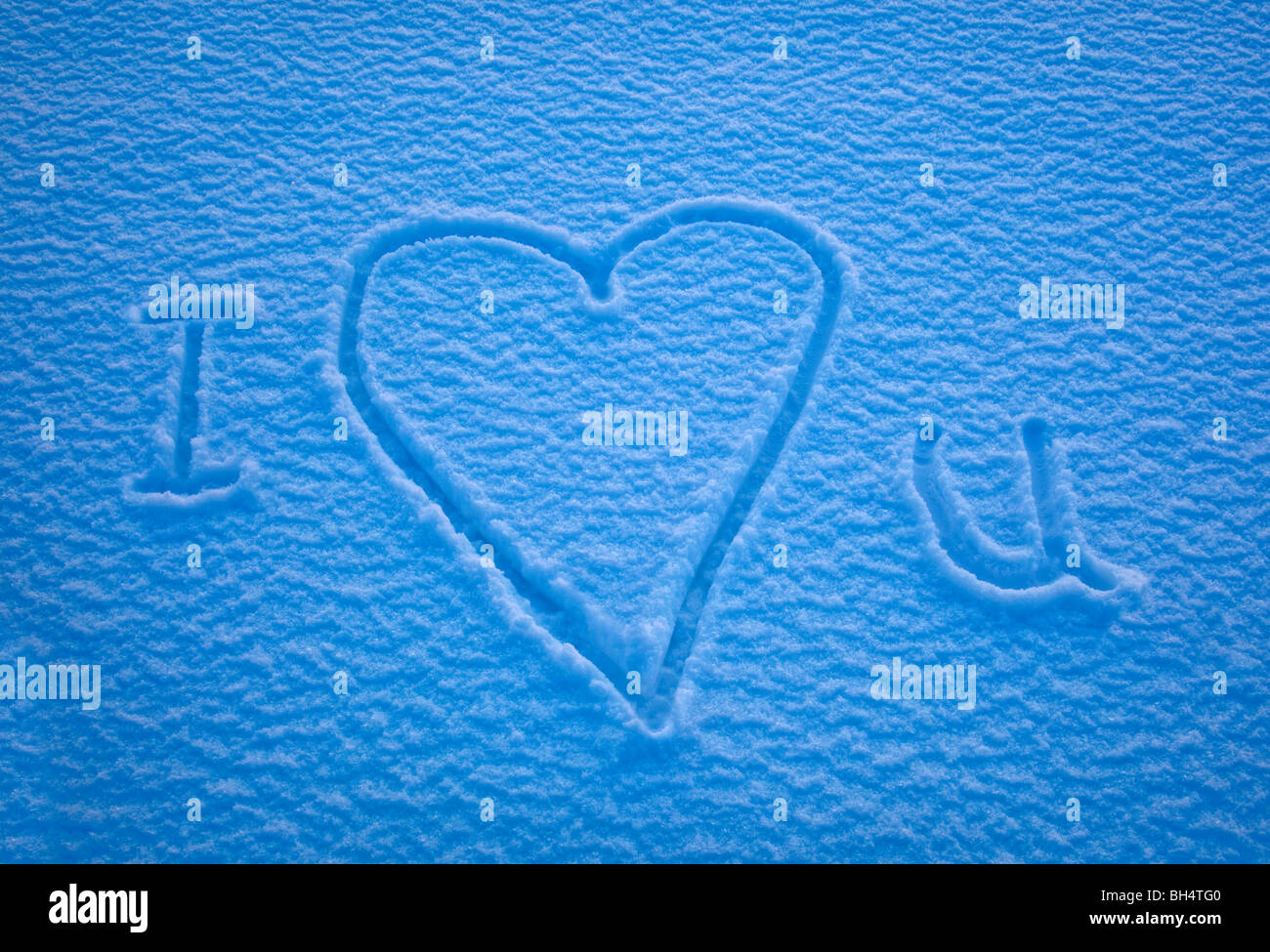 i love you spelled out in the snow with the heart symbol replacing