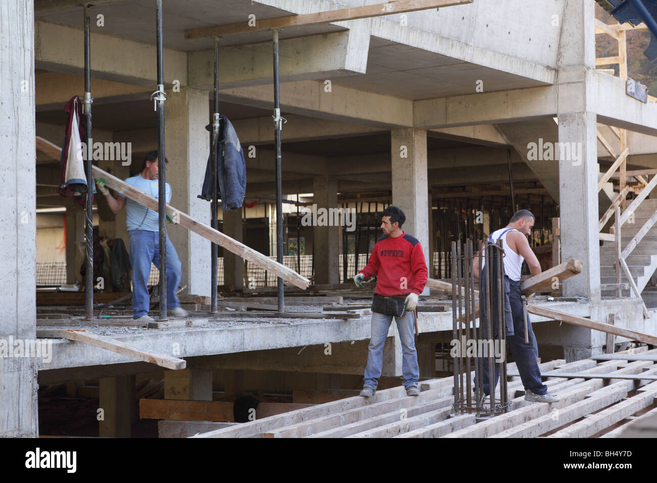 Workers on the construction of Olympic venues in Sochi, Russia - Stock Image