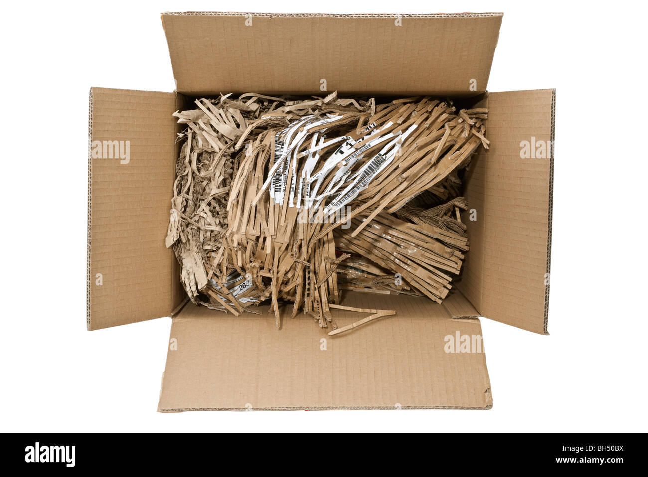 Looking down inside a cardboard box full of shredded cardboard recycled packing material - Stock Image