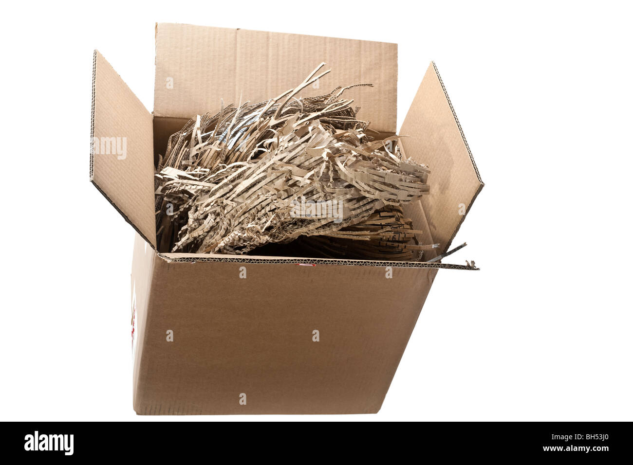 Cardboard box full of shredded cardboard recycled packing material - Stock Image
