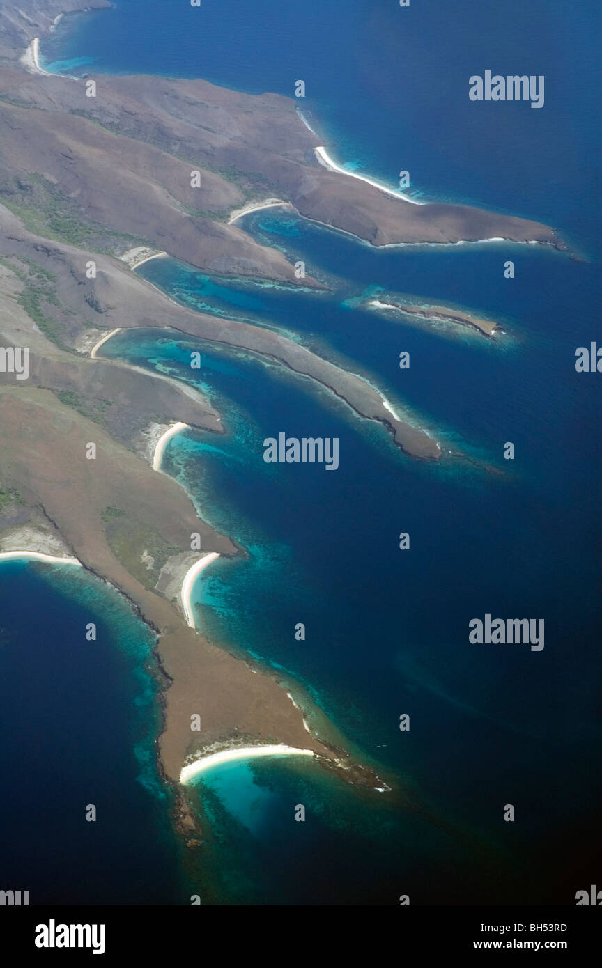 Aerial view of spectacular coastline and fringing coral reefs of Banta Island, Komodo Marine Park, Indonesia Stock Photo