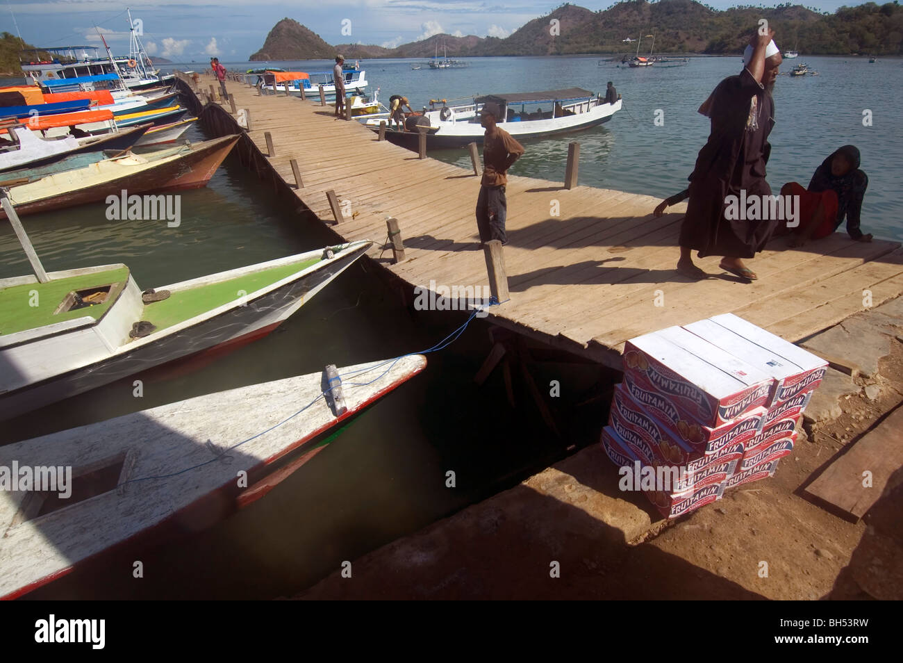 Jetty (slumping due to spectacularly rotted pilings) in harbour at Labuan Bajo, Flores, Indonesia - Stock Image