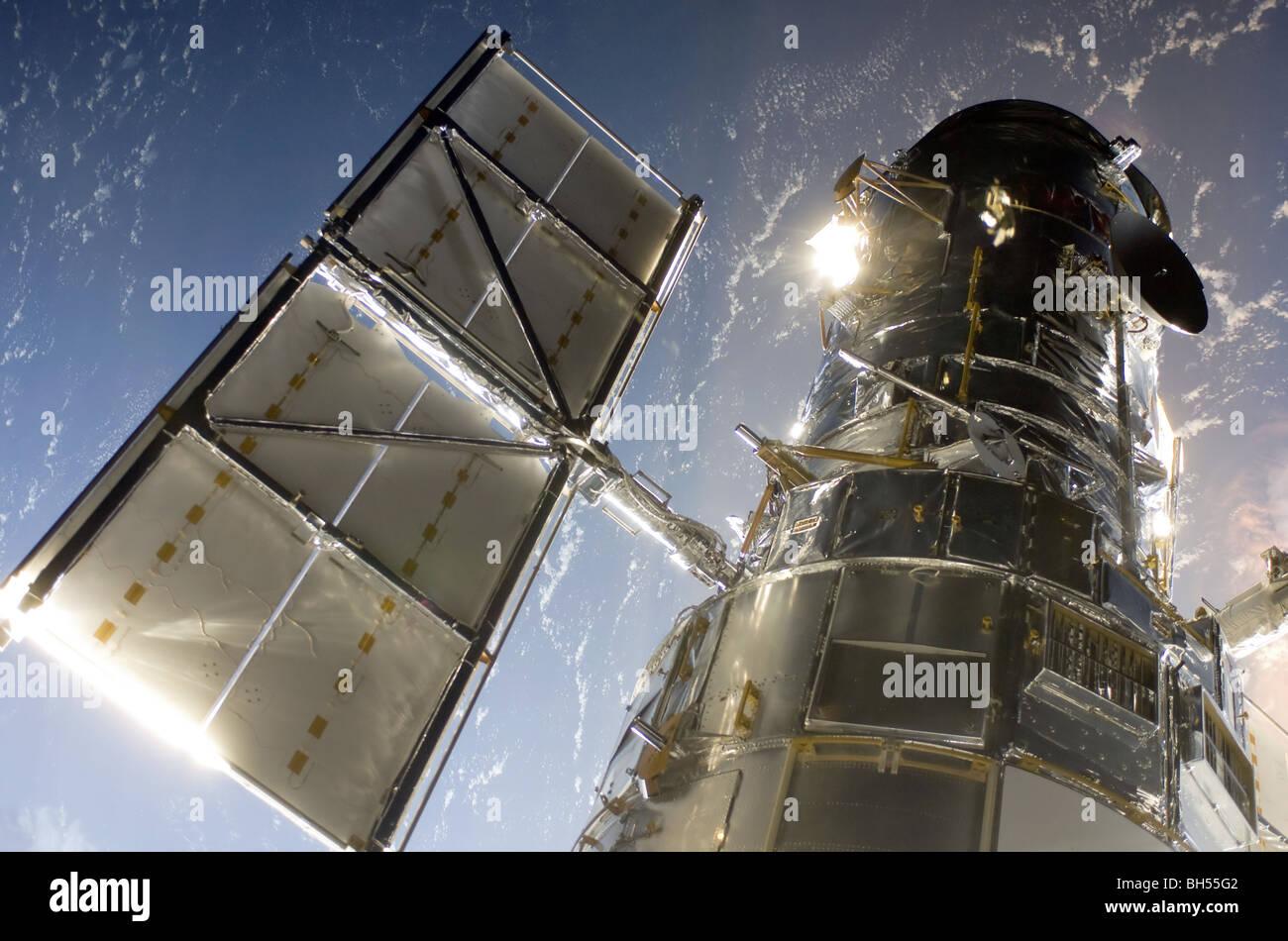 NASA Hubble Space Telescope above Earth - Stock Image