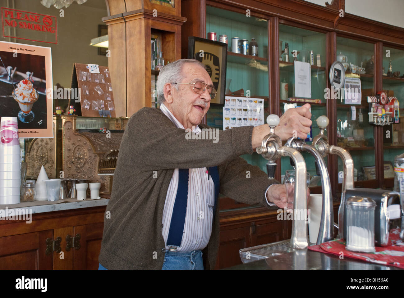 Roy is always busy making delicious treats in his old-fashioned ice cream parlor in Carrizozo, New Mexico. Stock Photo