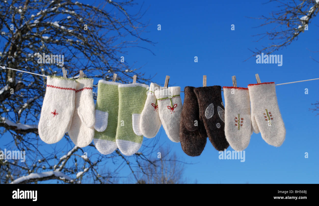 Gloves on a clothesline - Stock Image