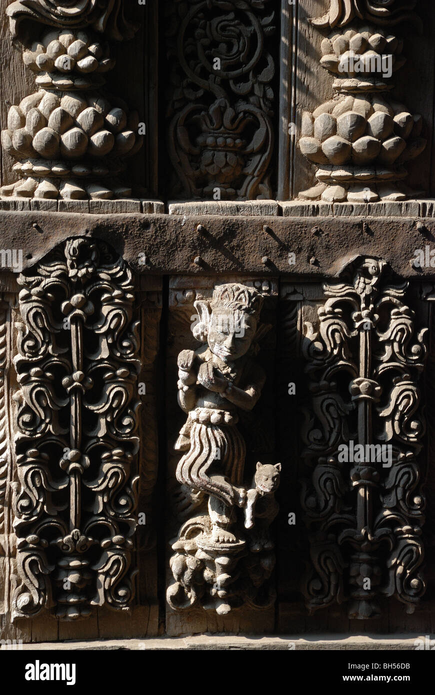 Carving of  musician in wooden roof of house in old Ahmedabad, India. - Stock Image