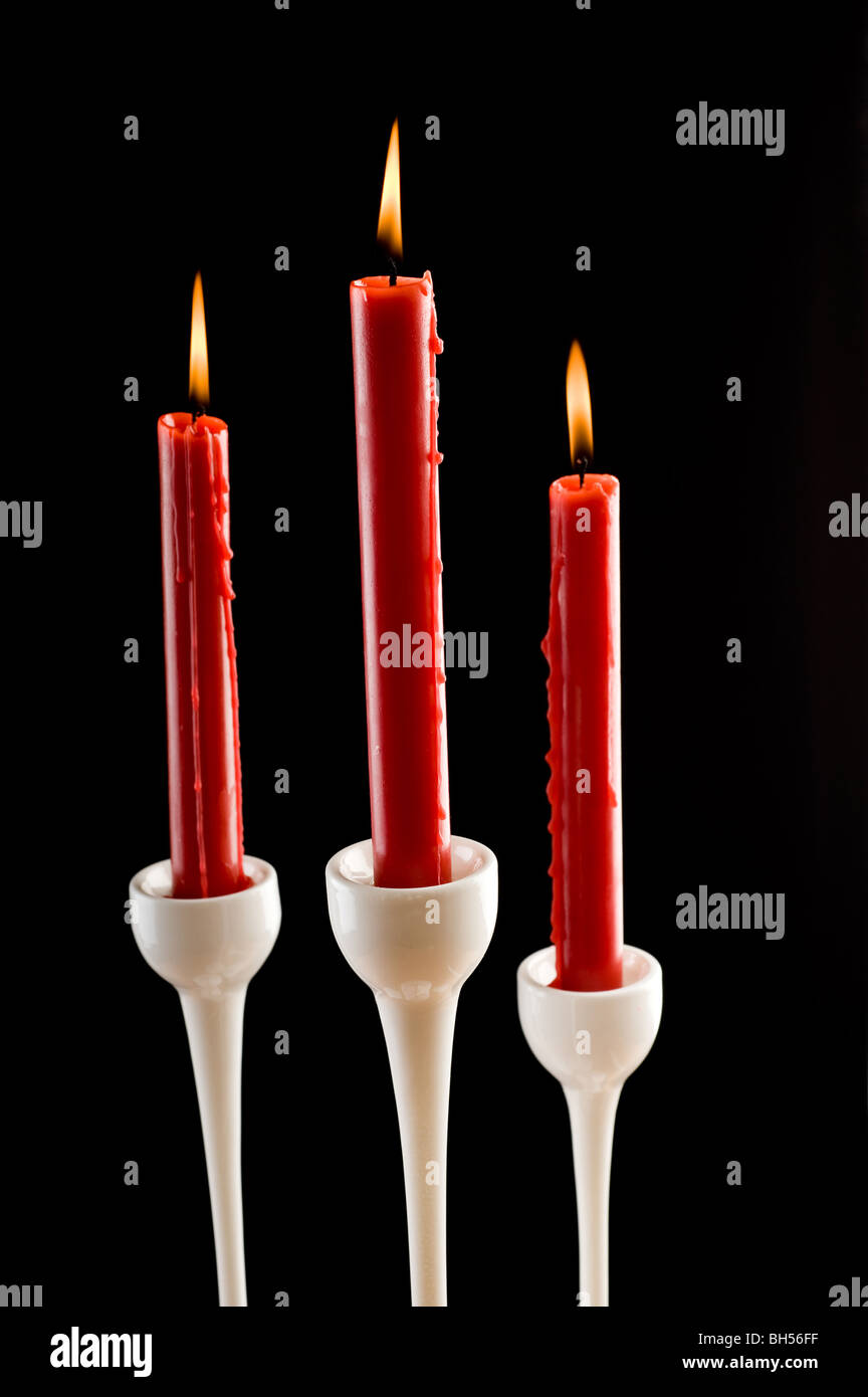 Candles on dark background - Stock Image