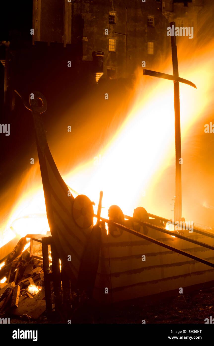 Dunvegan Castle, Isle of Skye - bonfire and burning of a replica Viking longship. - Stock Image