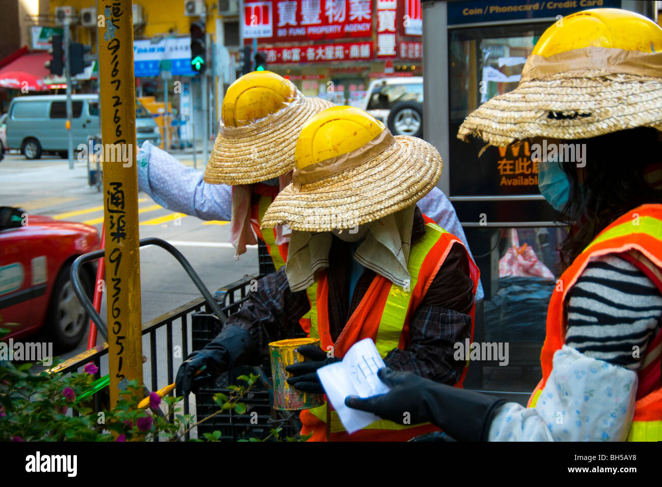 Honk Kong road workers - Stock Image