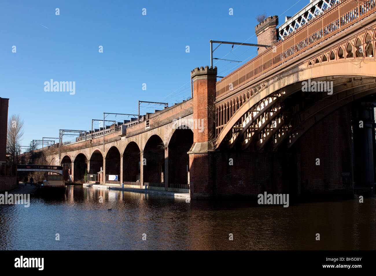Manchester canal and railway bridge arches in castlefield - Stock Image