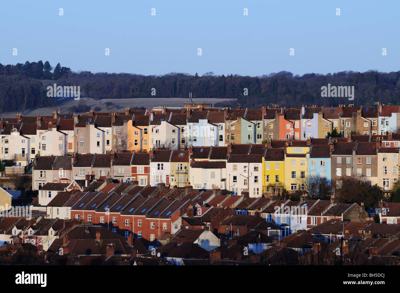 Old terraced housing tightly packed on a hill in cold morning light - Stock Image