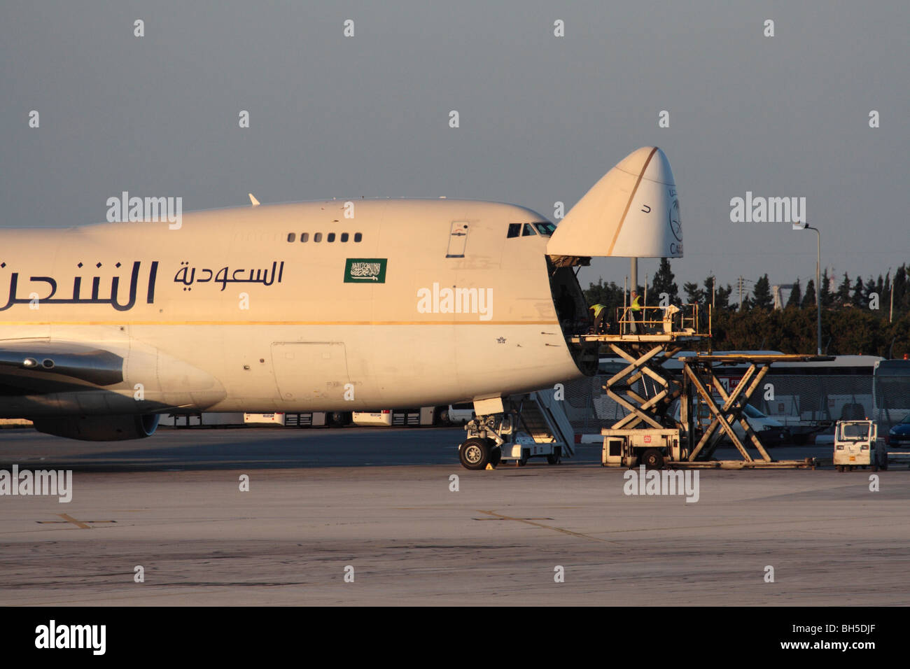 Saudi Arabian Cargo Boeing 747-200F jumbo jet transport plane with nose open ready for unloading - Stock Image