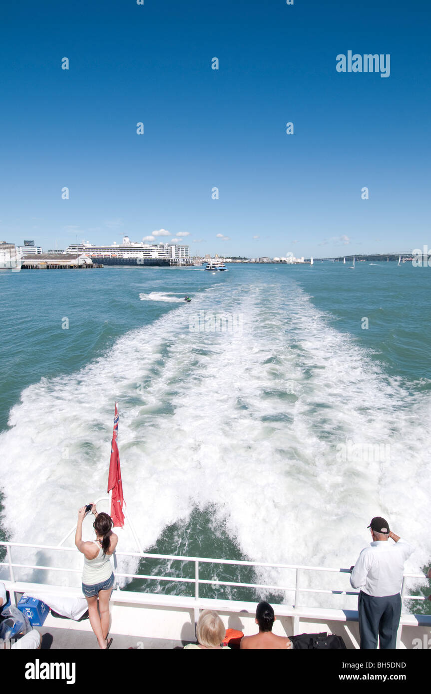 Passengers on the back of a ferry, crossing from Auckland to Waiheke island Stock Photo