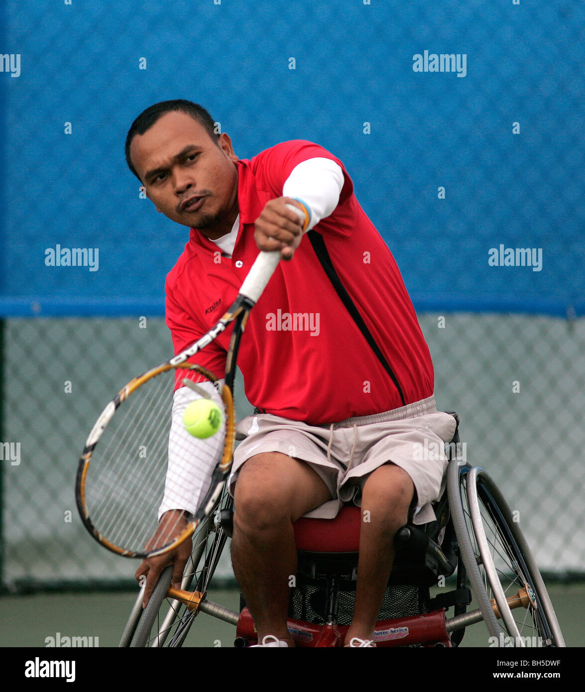 A competitor takes part in the Invacare World Cup of wheelchair tennis, held at Nottingham, 27th July - 2nd August. - Stock Image