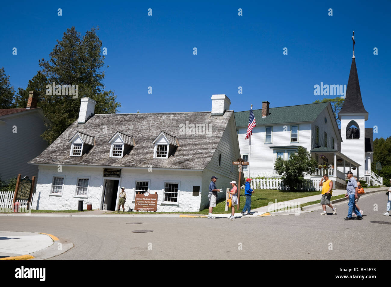 American Fur Company's retail store, Market and Fort Street, with Trinity Episcopal church, Mackinac Island, - Stock Image