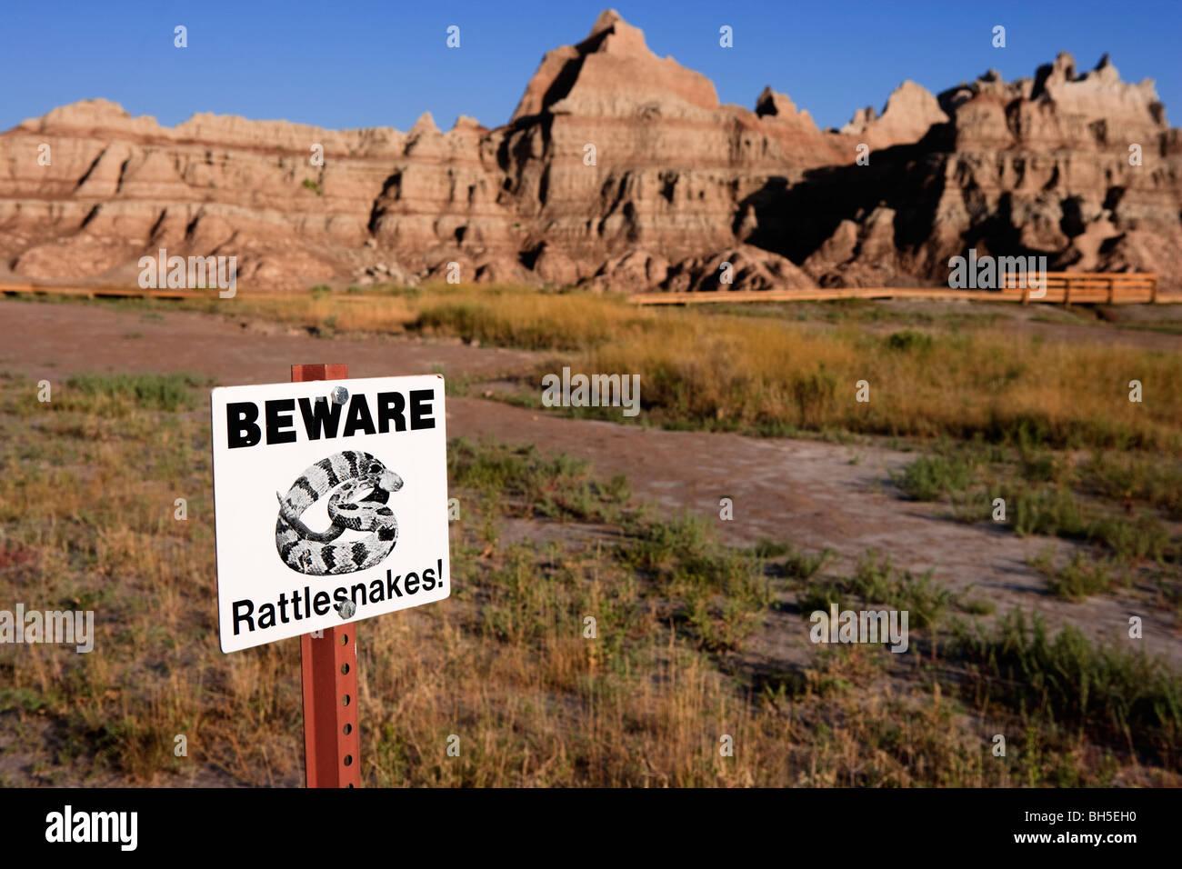 Beware of rattlesnakes warning notice Badlands National Park, South Dakota, United States - Stock Image