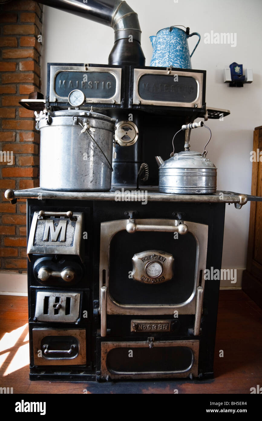 Old black Majestic stove with pot and large kettle, Big Horn County Historical Museum Hardin, Montana, USA - Stock Image
