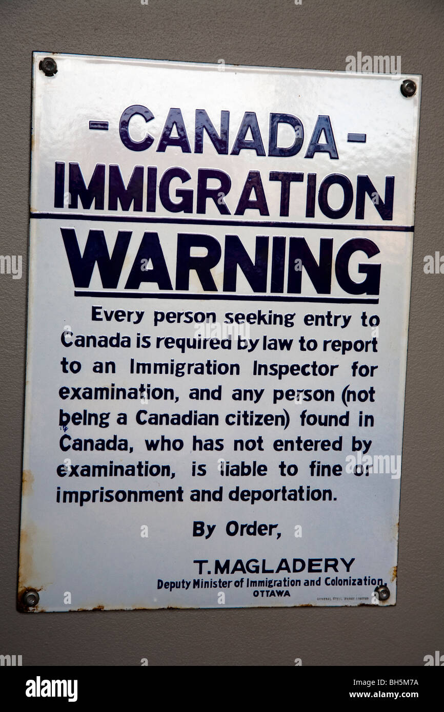 Rusted Canadian immigration warning notice - Stock Image