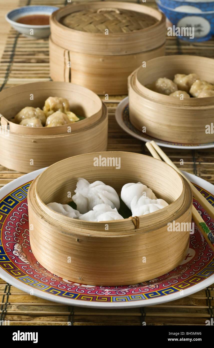 Dim sum Chinese dumplings in steamer baskets - Stock Image