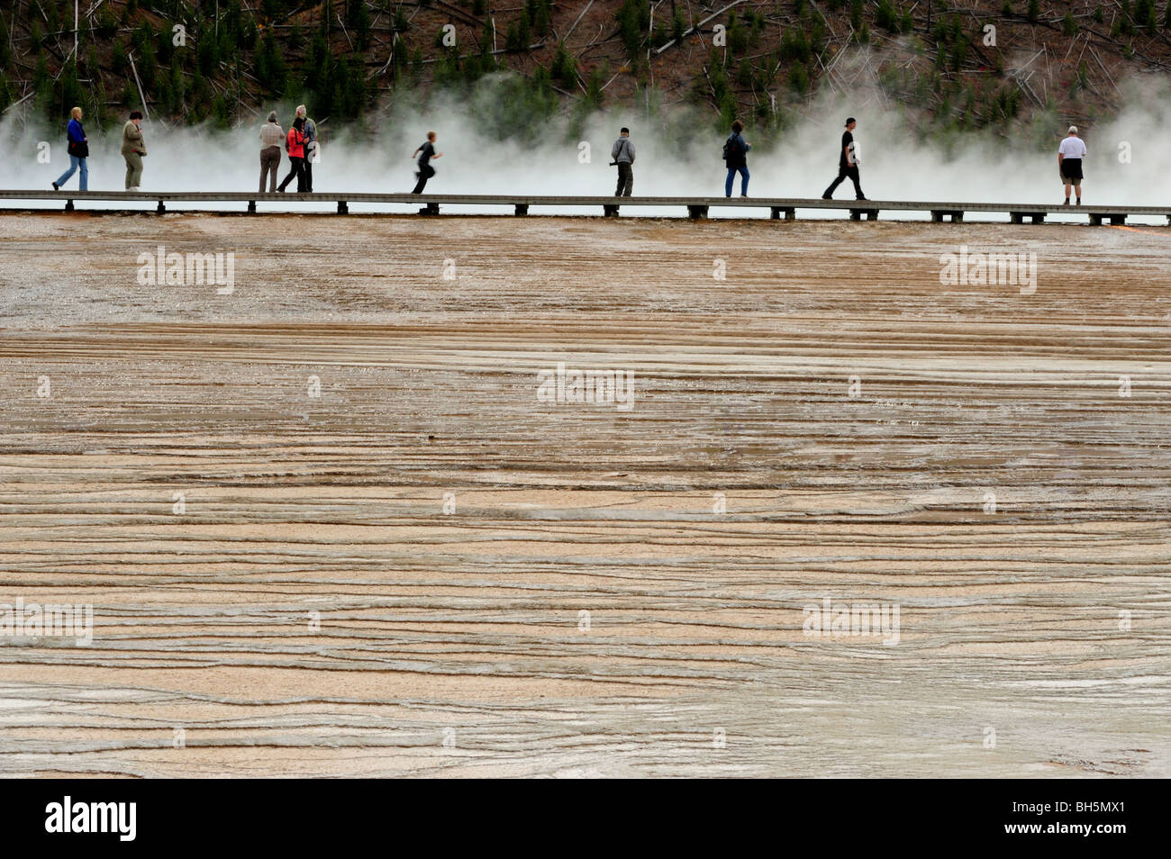 Tourists on boardwalk near Grand Prismatic Spring, Yellowstone National Park, Wyoming - Stock Image