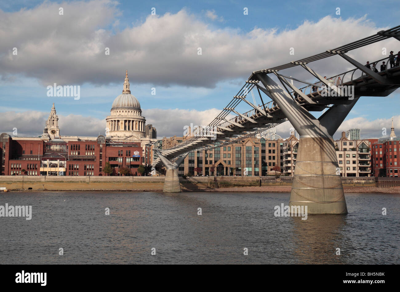 View from the South Bank of the River Thames towards the Millennium Bridge and St Pauls Cathedral, London, UK. Stock Photo