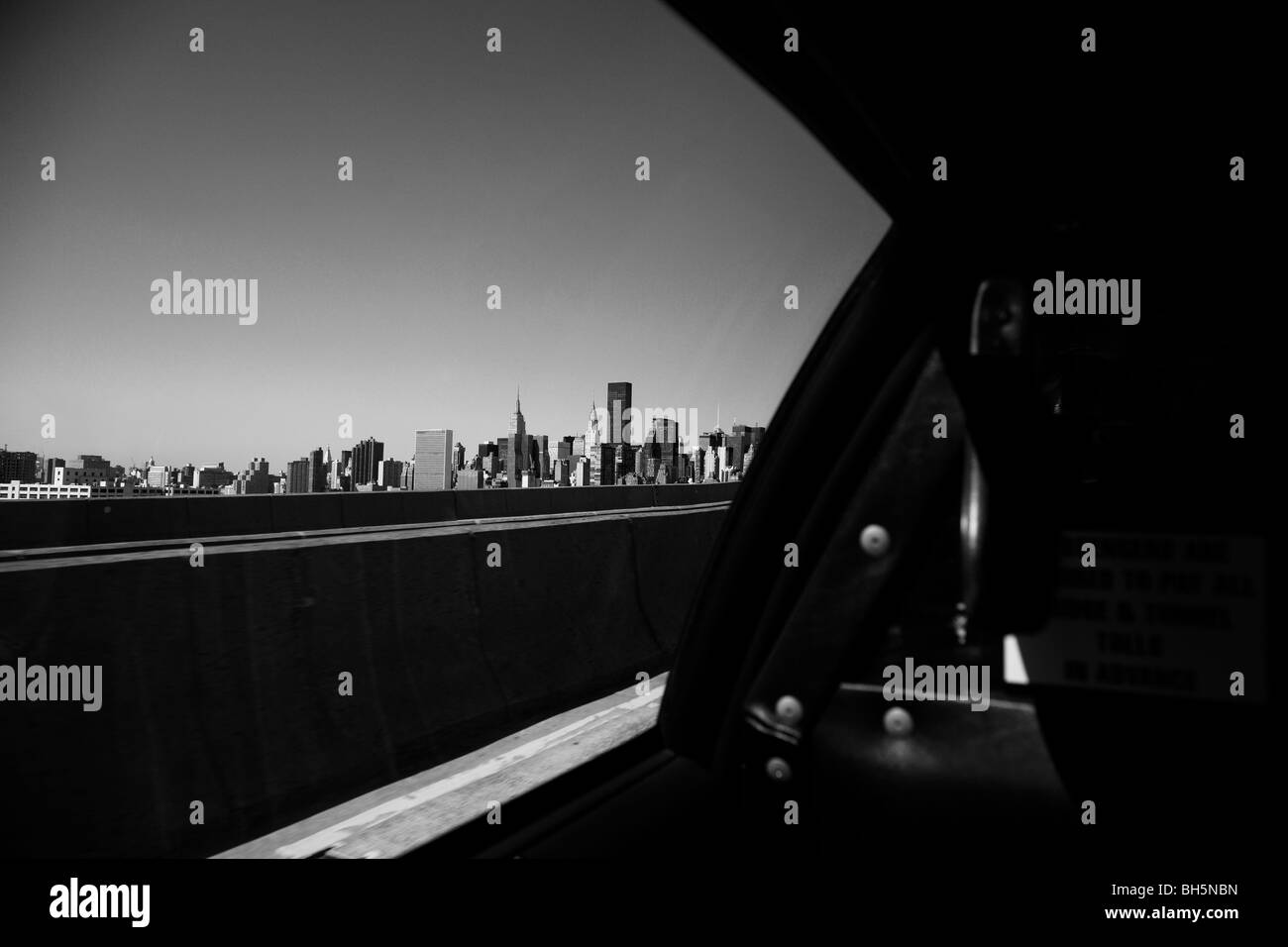 The Manhattan skyline from inside a NYC taxi cab approaching Queensboro Bridge, New York City, New York USA - Stock Image