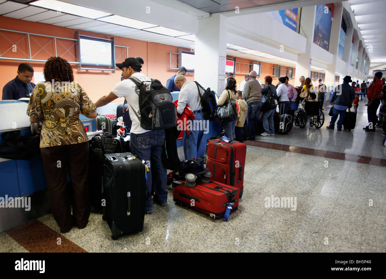 Airline passengers check in at Las Americas International Airport in Santo Domingo, Dominican Republic - Stock Image
