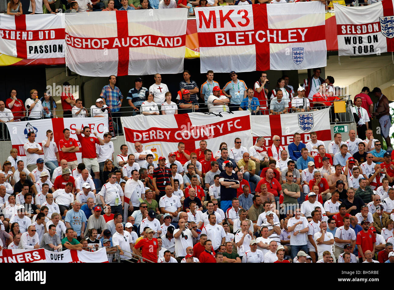 england football fans with their flags in the stands at