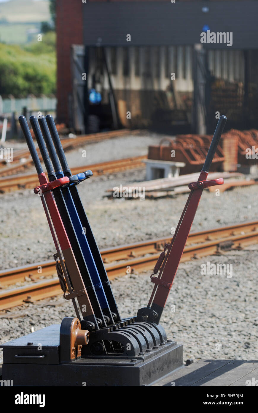 Levers for manual railway signal and points operation, Aberystwyth, Wales. - Stock Image