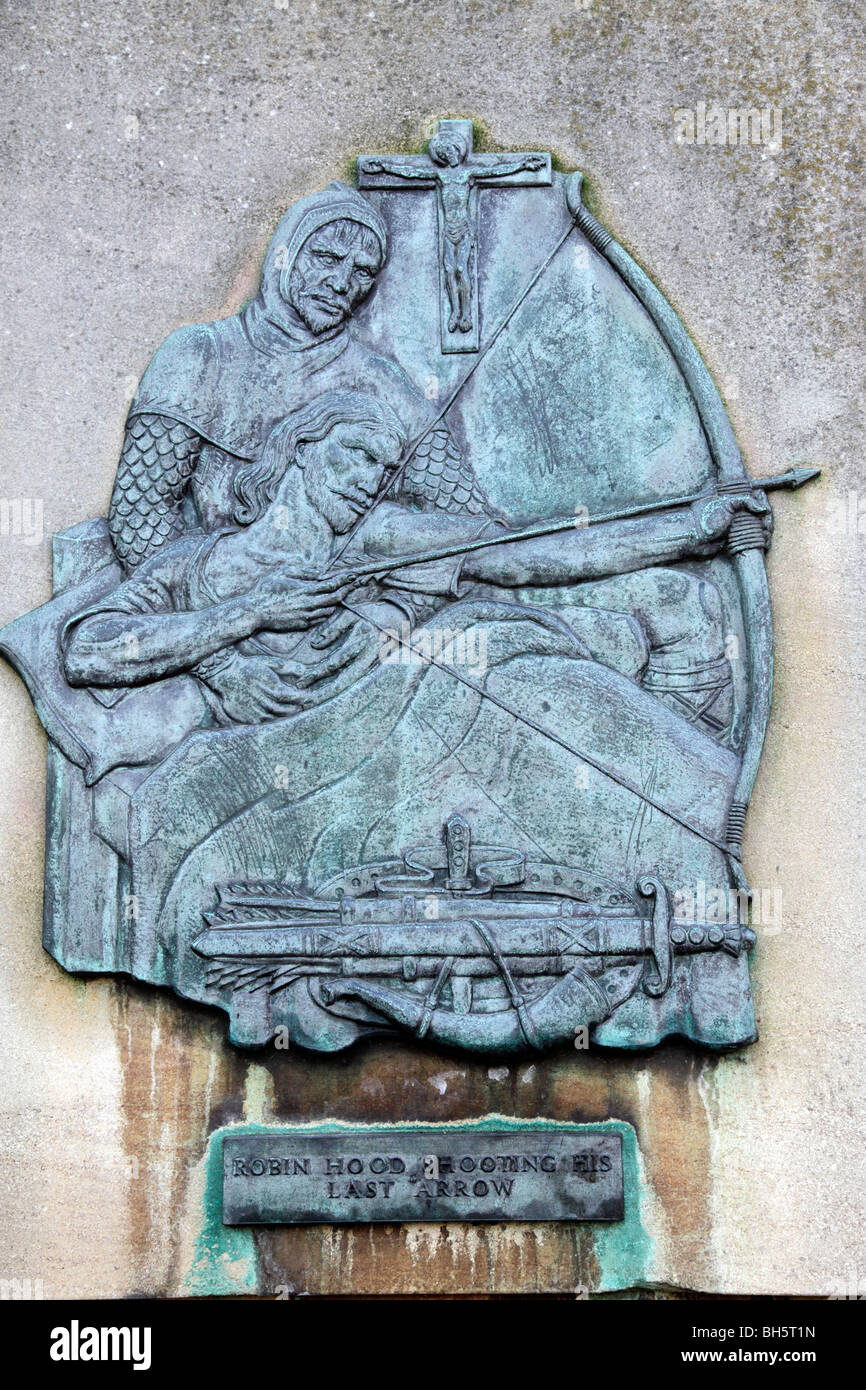 wall plaque showing robin hood shooting his last arrow castle road nottingham uk - Stock Image