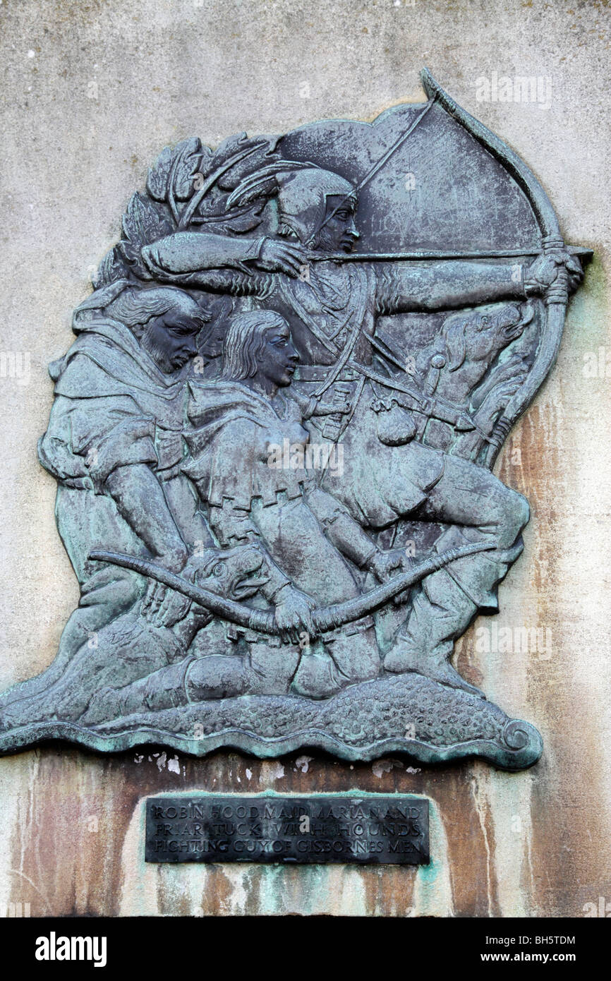 wall plaque showing robin hood and maid marian with friar tuck fighting gisbornes men castle road nottingham uk - Stock Image