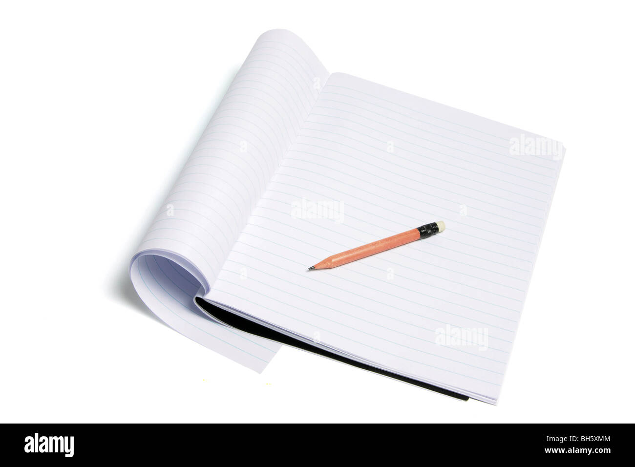 Exercise Book and Pencil - Stock Image