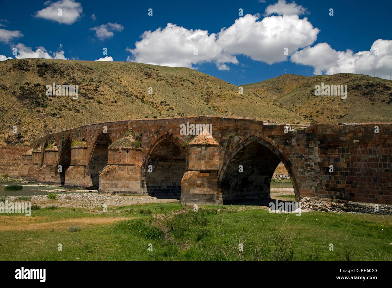 Historical Cobandere Bridge built in 1298 on Aras River, Kars Turkey. - Stock Image